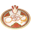 Decorative puja thali with ganesh and deyas