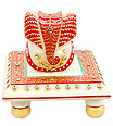 Decorative ganesh sitting on chowki carved from marble